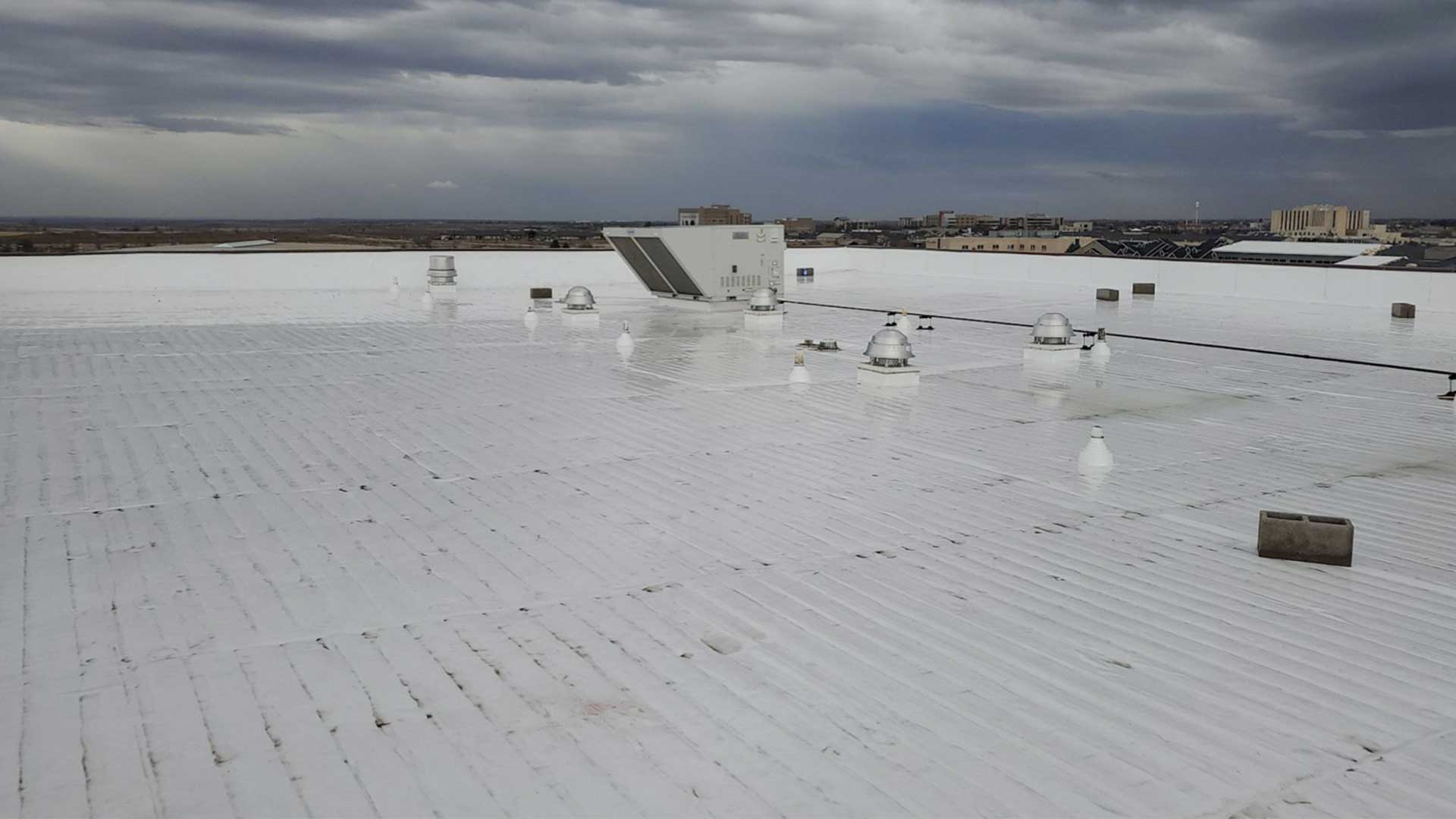 tascosa-roofing-commericial-roof-rain